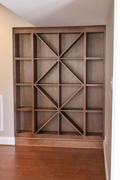 Custom wine rack. Hmmm. Like this on a smaller scale combined with a bookshelf for in the CLEAN garage