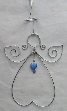 wire angel - I would put the wings upside down and make them longer and bigger. I will also add crystals and beads and things. Wire Crafts, Bead Crafts, Jewelry Crafts, Wire Wrapped Jewelry, Wire Jewelry, Jewellery, Christmas Angels, Christmas Ornaments, Christmas Diy