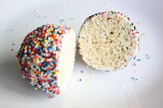 egg-shaped rice krispie treats coated with melted white chocolate and covered in rainbow sprinkles... <3