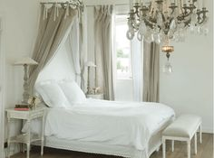 Love the clean look, loose curtains over the bed