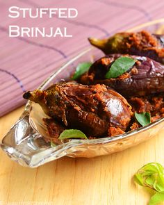 Stuffed brinjal curry with spices that makes it flavorful and exotic. Full video and with step by step pictures.