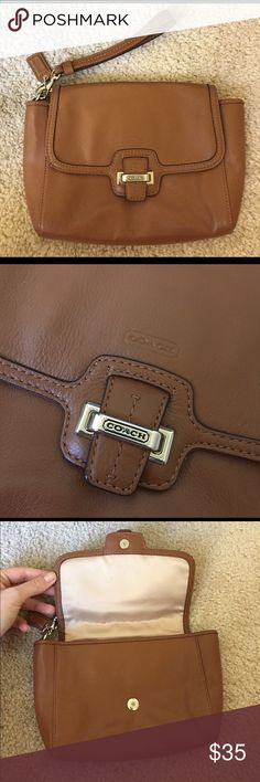 Rare Coach Genuine Leather Wristlet Hard piece to find! New, never used. Soft leather in a medium brown color. Great size! Coach Bags Clutches & Wristlets