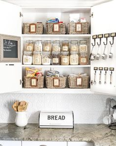 Create a cooking command center with a pantry cabinet full of jars, baskets, a shopping list, + all your measuring spoons.