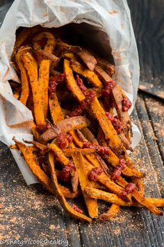 Hot and spicy dirty south sweet potatoes fries sprinkled with homemade cajun seasoning.