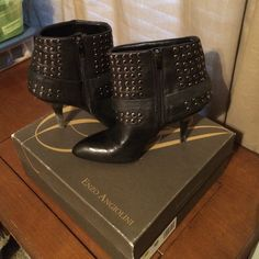 Black leather boots with silver studs Only worn a couple times.  Black leather boots with silver studs.  In excellent condition. With box. Enzo Angiolini Shoes