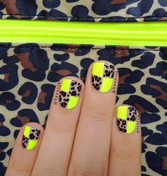 Beautiful animal print nail art design. The animal prints are creatively placed as there are small yellow boxes alternatively placed as well. Thus this makes a truly unique looking nail art design.