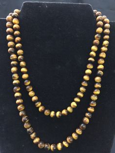 WONDERFUL PAIR OF TIGER EYE BEADED NECKLACES MEASURING 19 AND UP TO 21 INCHES IN LENGTH. CLASPS MARKED 925 AND SILVER. BOTH IN GREAT CONDITION WITH SUPERB QUALITY TIGERS EYE.