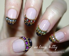 bejeweled nails.... interesting idea..