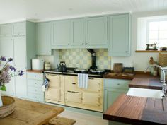 pale blue #kitchen cabinets and dark wood butcher block counter tops