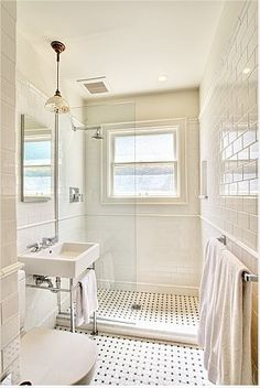 Love the floor tile in this bathroom. All white is my bathroom at the moment but this has more textures