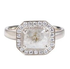 Semi-translucent light grey raw diamond with a sparkling pave halo by Anne Sportun at Greenwich Jewelers  $5175