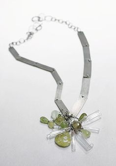 "Karen Gilbert: , Necklace in sterling silver, green garnet and Pyrex glass. 16"" long adjustable chain. Pendant dangle hangs 2"" long."