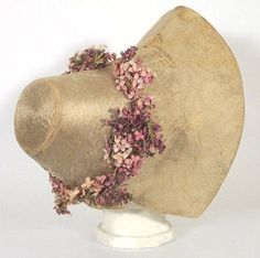 1830s bonnet with a wreath of lilacs.
