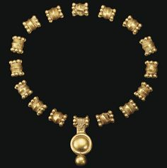 SIXTEEN SOUTH ARABIAN GOLD BEADS   CIRCA 5TH CENTURY B.C.   Including fifteen biconical beads with seven large granules encircling each end, and one pendant bead with a ribbed tubular suspension loop with similar granules encircling each end, a ribbed rectangular projection below, with a pyramid of granules on each side, and a large domed disk, ribbed on the sides, with a rounded border, terminating below in a single large sphere  Pendant bead