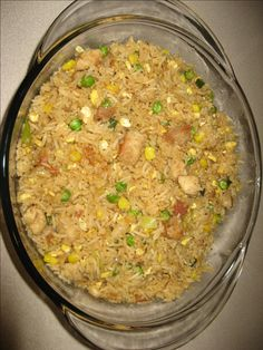Cook rice separately cool it in a mesh bowl or a large pan. Keep aside. Cut chicken breasts into thin cubes. Marinade with salt pepper juice of lime for 15...