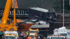 As investigators combed through the wreckage of the Amtrak train, officials vowed to restore confidence in rail safety.