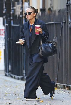 Mary-Kate Olsen Out And About In A Navy And Black Satin Look