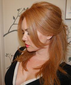 Bridgette Bardot strawberry blonde hair half-updo.
