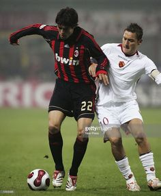 Kaka of Milan is challenged by Francesco Totti of Roma during the Serie A match between AC Milan and Roma at the Giuseppe Meazza Stadium on November 11, 2006 in Milan, Italy.