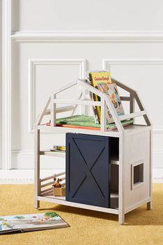 Bring a touch of farmhouse decor to your little one's room with this oh-so-charming barn bookshelf, which features a sliding door and shelves for storing their favorite toys and books. Unicorn Wall Art, Engineered Hardwood, Occasional Chairs, Toy Storage, Nursery Room, Nursery Decor, Sliding Doors, Baby Toys, Bookshelves