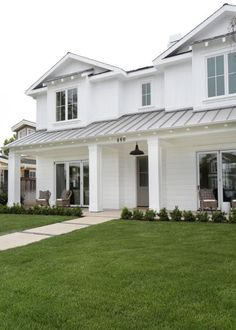 HGTV: Blackband Design put a modern-day twist on this white farmhouse, giving some of its rooms a subtle coastal vibe.