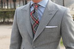 nice wool neck piece with a subtle pocket square to bring the ensemble to a T