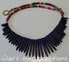 This necklace is made of multi - color howlite 4&6 mm round beads with purple howlite graduated sticks.
