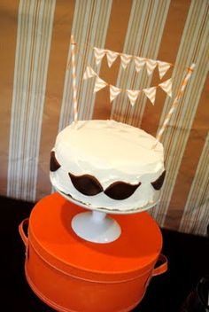 Mustache Cake!  Buttercream cake with fondant 'staches (cut with leaf-shaped fondant cutter)