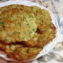 Zucchini-Potato Latkes -  Have a bounty of zucchini sprouting in your summer garden? Try these delicious, crispy fried latkes (pancakes) that combine both zucchini and potatoes..