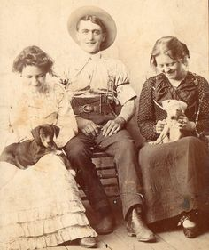 I saw this in my travels, very neat old photo of a cowboy & women with dogs.