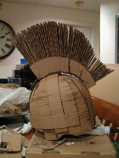 Roman Soldier soldier helmet made of cardboard. Good idea for youth Easter play. Finish it off with crinkle gauze cloth, paint, and rub and buff.