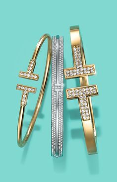 Tiffany T bracelets in 18k yellow and white gold with diamonds.