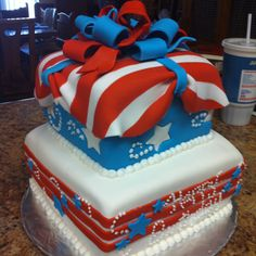 Red, white, and blue birthday cake. Patriotic flag, all hand made and edible. Coconut cream cake with lemon curd filling.