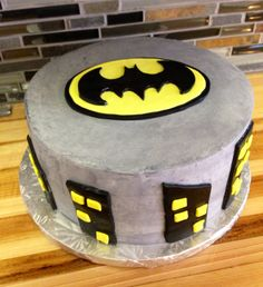 Batman Birthday cake with logo and buildings