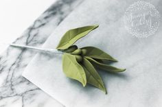 A spray of sugar flowers just isn't complete without some filler leaves. The good news: You don't need a whole collection of silicone veiners to create fondant leaves. Find out how the bakers behind Juniper Cakery create beautiful leaves with tools almost every cake decorator already has.