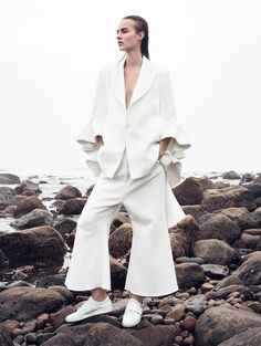 Maartje Verhoef wears black-and-white looks and poses on a rocky-shore-background for the January 2016 issue of Vogue China, captured by Sharif Hamza and styled by Tiina Laakkonen. Vogue Editorial, Beach Editorial, Editorial Photography, Editorial Fashion, Fashion Photography, White Editorial, Glamour Photography, Lifestyle Photography, Édito Vogue