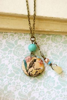 Summer bohemian bird locket charm necklace by tiedupmemories, for sale on etsy. She collaged a vintage locket.