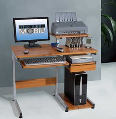 This Techni Mobili Multifunction Computer Desk saves space with its compact footprint. It has a simple yet sturdy design made of heavy-duty engineered wood panels with a moisture resistant PVC laminate veneer and a scratch-resistant powder-coated steel fr Computer Workstation Desk, Computer Desk Design, Small Computer, Desk Storage, Storage Spaces, Ikea Series, Best Desk, Bookshelves Built In, Desktop Organization
