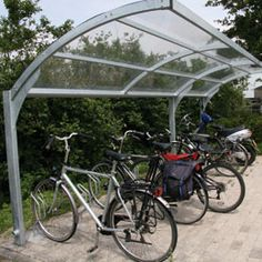 High clear shelter.  http://www.falco.co.uk/products/shelters-canopies-cabins/cycle-shelters-and-bicycle-storage/falcogamma-hi-bike-shelter/