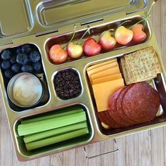 Homemade lunchables are the best! Pic courtesy of @sharing_healthy_eats on Instagram Inside: + Celery Sticks+ Salami, cheddar cheese and wheat thins+ Blueberries and yogurt+ Cherries + Chocolate chips