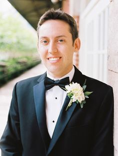 Classic groom look. Bow tie and an elegant boutonniere | Steven Wallace Photo