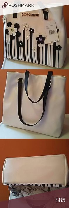 NWT Betsey Johnson Tote Gorgeous Betsey Johnson Black & Cream Flower Lane Center tote. Never used, tags still on. Perfect for Spring/Summer! Magnetic snap closure, lined interior has 2-slip pockets and 2-zip pockets. Betsey Johnson Bags Totes