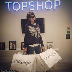 Undercover shopper: Paris Hilton went to a London Topshop store in disguise on Tuesday, where she picked up several bargains and posted the results to her Instagram account
