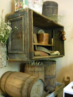 Old Distressed Drawer...repurposed into a primitive wall cupboard with oldes...weathered & worn barrels.