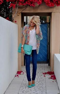 aqua clutch and heels with skinny jeans and a floral blouse
