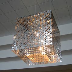 LUSTRE BUBBLE CEILING SQUARE  Materials: Stainless steel Dimensions: 27.3 on each edge (cubic)  Options: Polished stainless steel, custom finishes available upon request