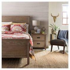 The Threshold??™ Gilford Queen Bed - Rustic Gray combines the grandiosity of traditional design with the simplicity of modern bedroom furniture. This wooden bed frame has a large, solid wooden headboard with a matching, lower-profile foot board. It's a classic sleigh bed design that can accommodate either a box spring or a rolled slat system. Bold yet understated, this is a modern bed with a timeless look.
