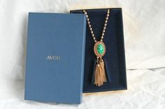 Vintage Avon Bolo Lariat Necklace Green Ming Book Piece by D and E Tassels New in Box. $42.50, via Etsy.