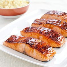 Glazed Salmon with Soy Mustard Glaze- America's Test Kitchen. Usually the glaze slides right off but the cornstarch/sugar coating helps the glaze adhere to the surface. Would totally make again.