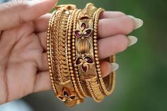 Check out this matte gold finish antique bangles by the brand Accessory villa. Plain Gold Bangles, Gold Bangles For Women, Gold Bangles Design, Gold Earrings Designs, Gold Jewellery Design, Indian Gold Jewellery, Gold Temple Jewellery, Indian Wedding Jewelry, Antique Jewellery